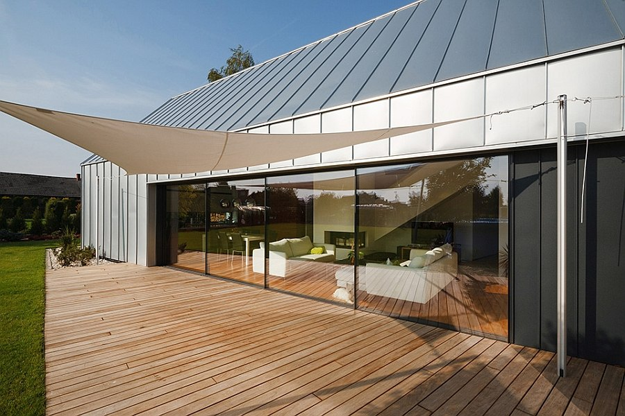 Shaded wooden deck connected visually with the living area
