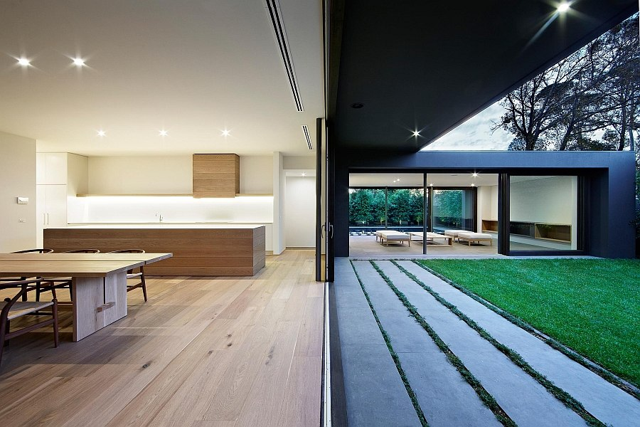 Sliding glass doors offer seamless connectivity between the interior and the outside world