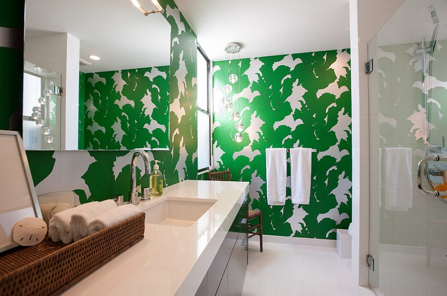 Small guest bathroom with bright green wallpaper shaping the accent wall