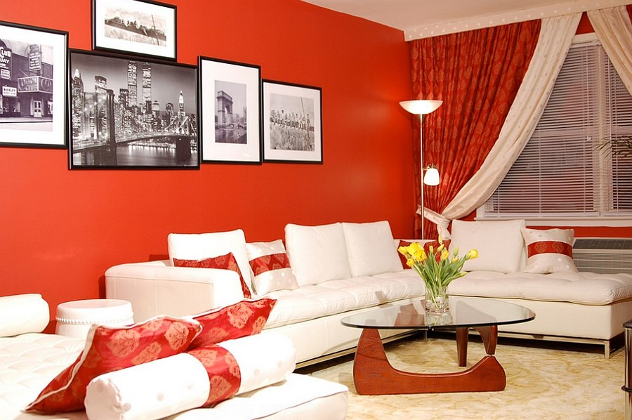 Small living room with red walls and Noguchi table [By: Marie Burgos Design]
