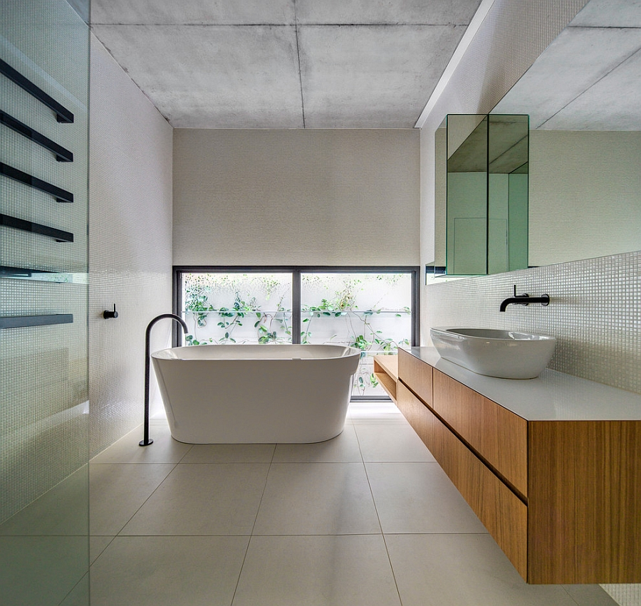 Spa-like home bath with a standalone bathtub in white