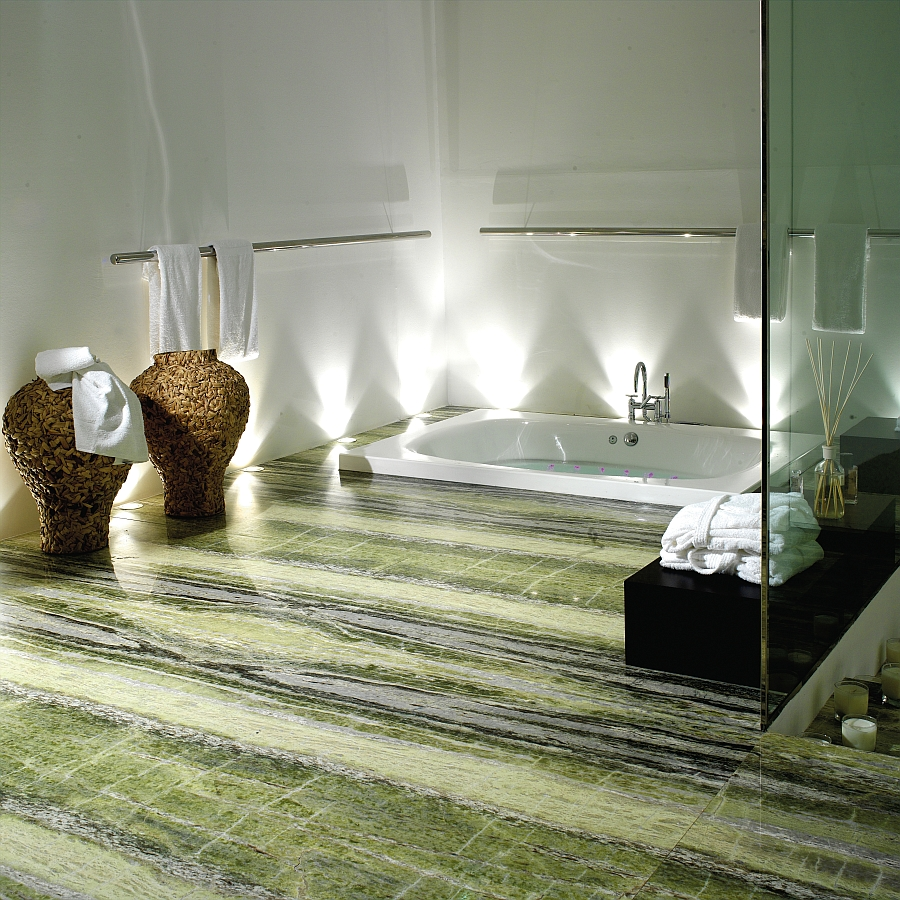 Spa-like sensational bath at home with sunken bathtub and natural stone floor