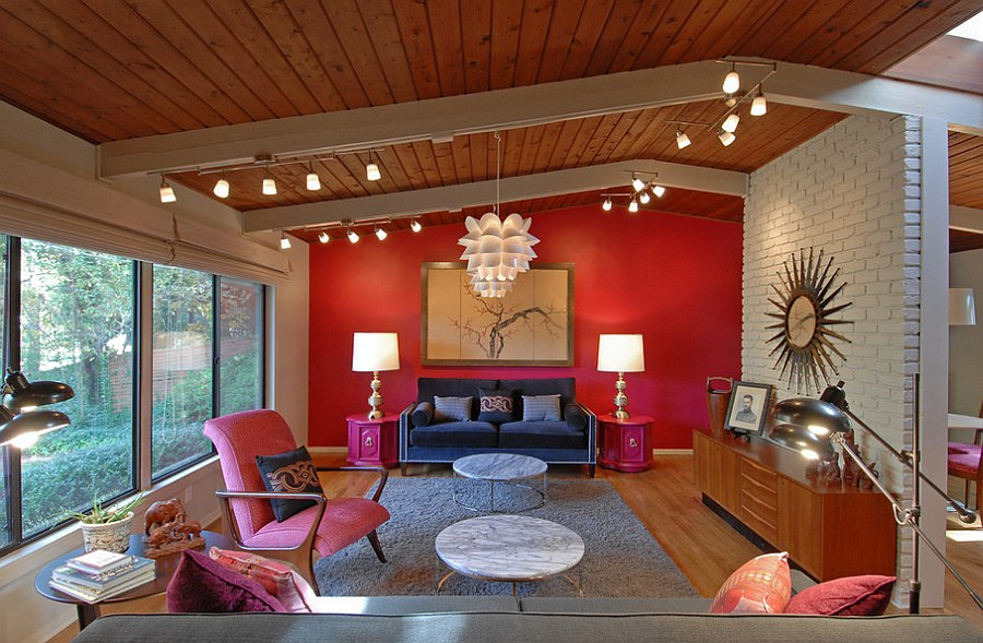 Spacious living room combines hot pink with red [By: Brian Patterson Designs]