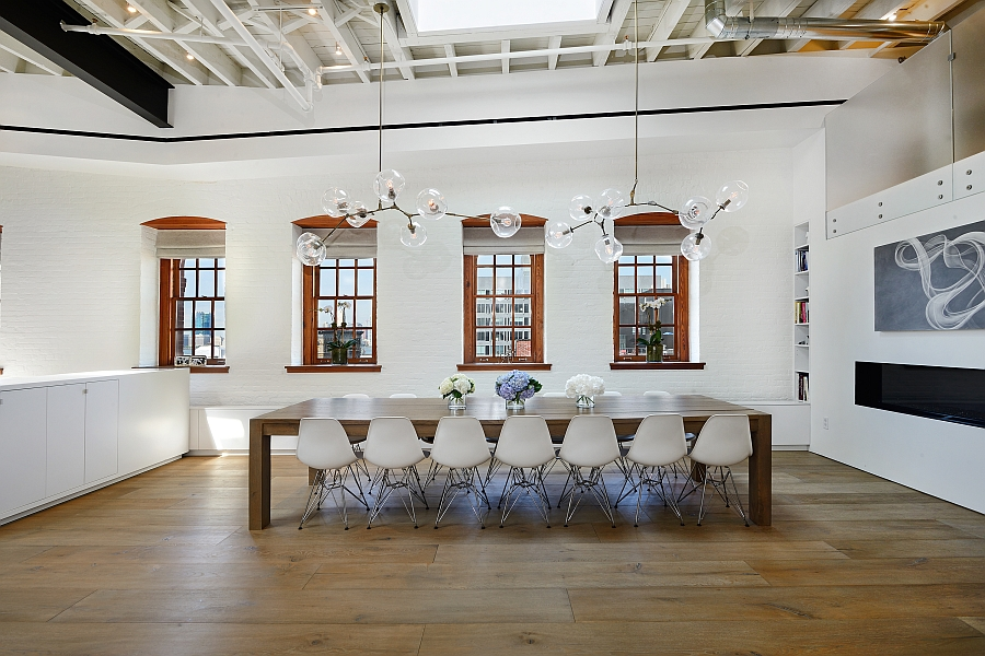 Sparkling chandelier lighting steals the show in the dining area
