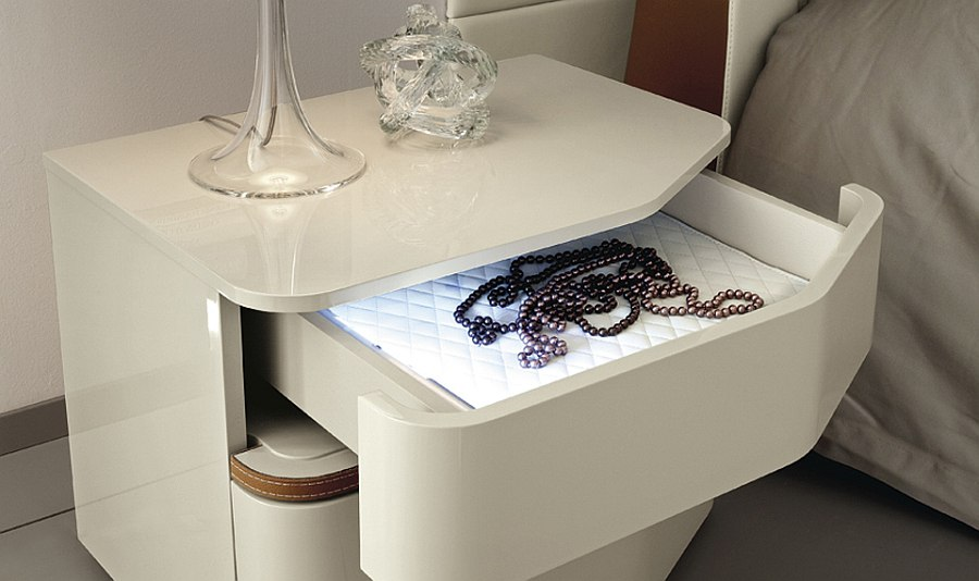 Specially crafted bedside tables with lovely contours and internal light