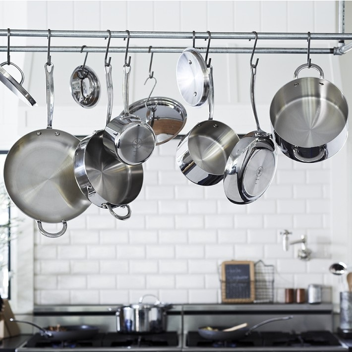 Stainless steel pots on a hanging rack
