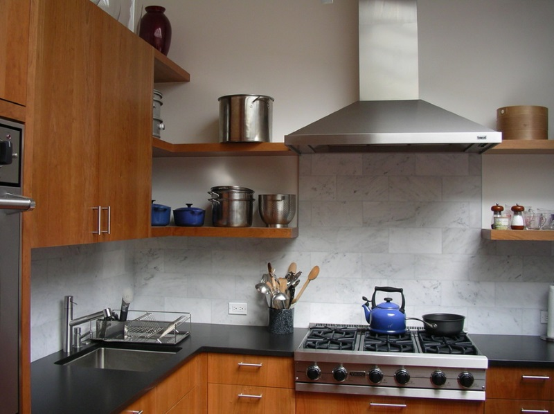 Stainless steel pots on open shelving in a contemporary kitchen