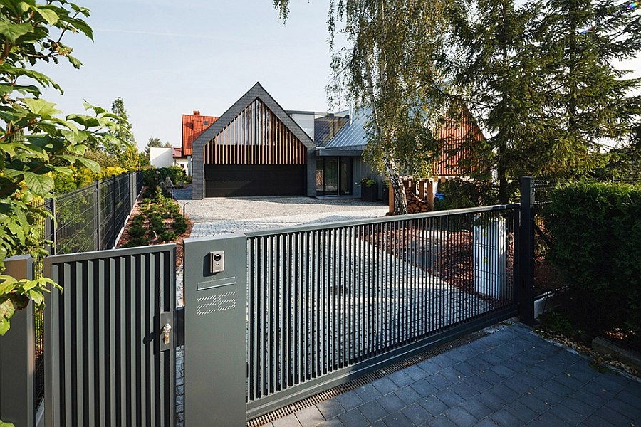 Street facade of the stylish Two Barnes House by RSPlus