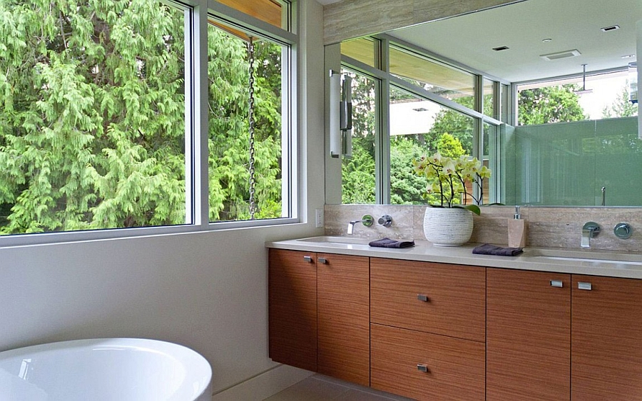 Stylish contemporary bathroom with floating wooden vanity