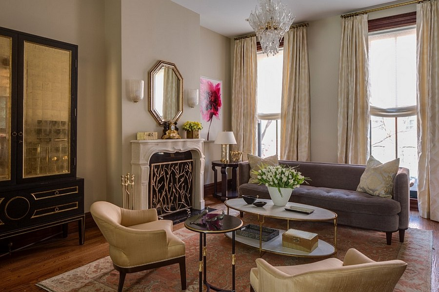 Stylish golden accents give the living room a touch of majestic allure