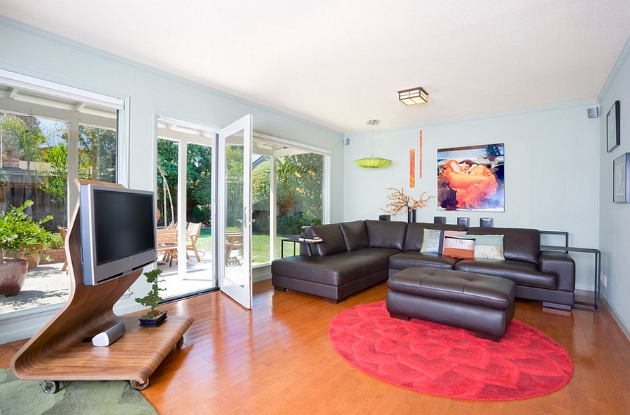 TV need not be a permanent fixture in the family room How To Design A Trendy, Fun Family Room