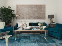 Teal blue overdyed rug in an eclectic living room