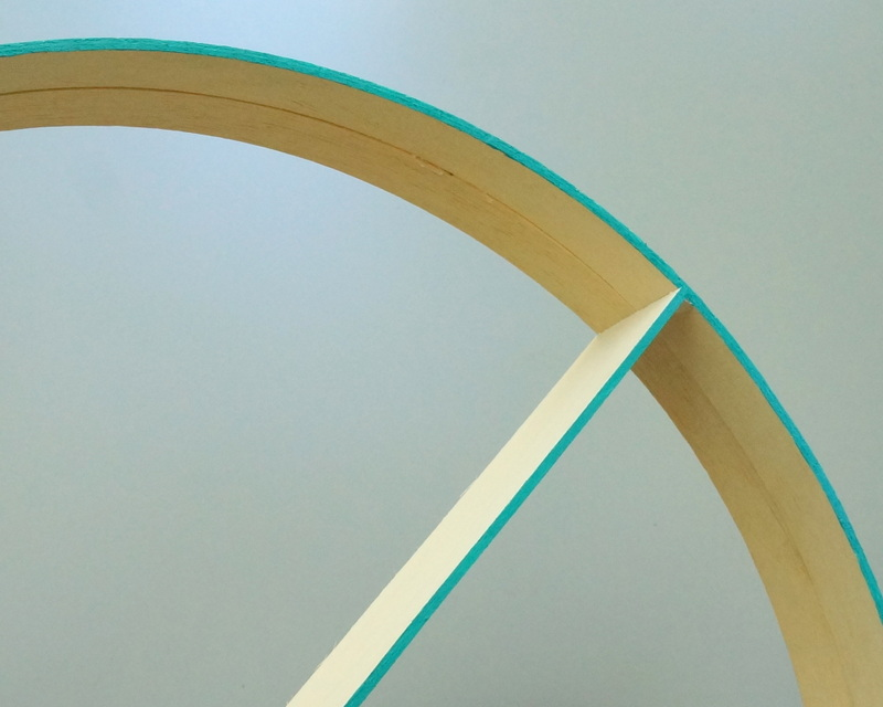 Teal paint on the edge of a round shelf