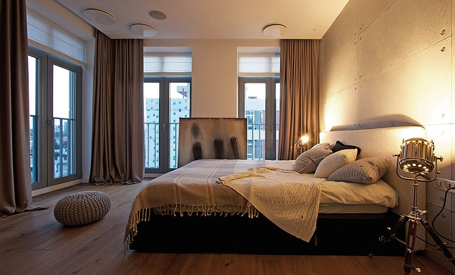 Tripod floor lamps used as bedside lighting