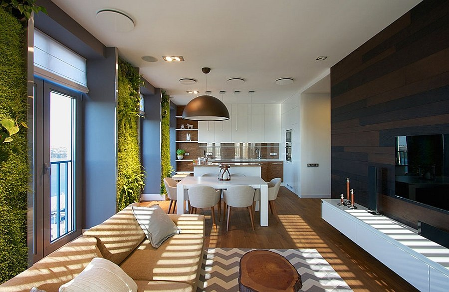 Vertical gardens in apartment living room coupled with natural colors