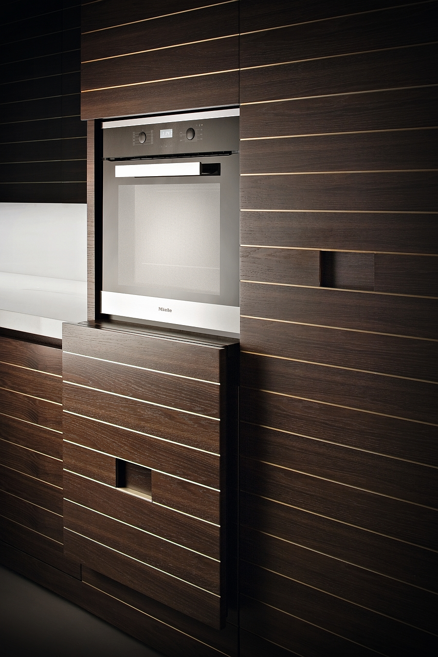 Vertical sliding system that reveals the oven when needed