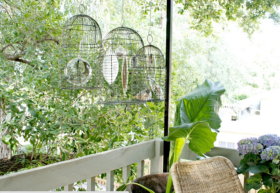 Vintage birdcages with encased feathers make a unique decor item [Design: Katie Gagnon]