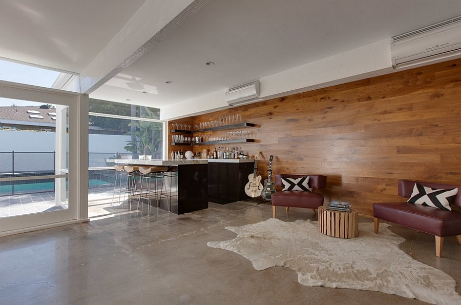Walnut wood accent wall brings elegance to the home bar and lounge
