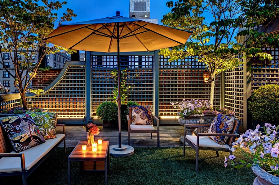 Warm lighting enhances the appeal of the stunning rooftop garden