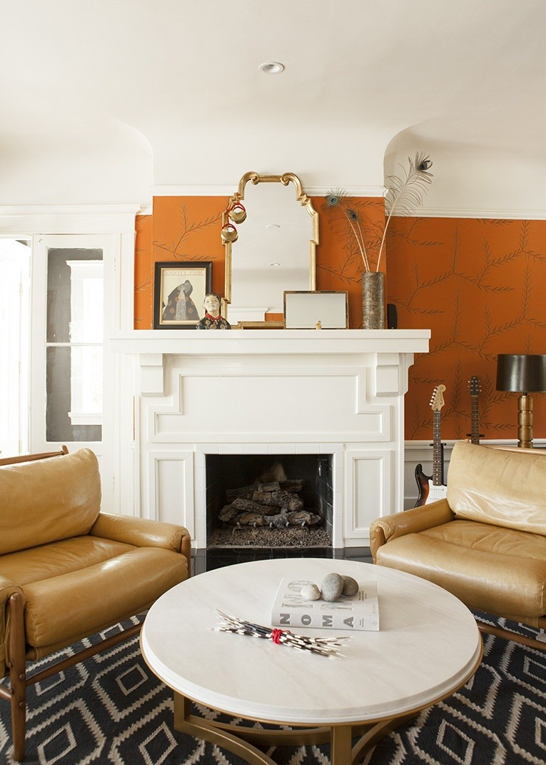 Warm tones and interesting details in a room with a fireplace