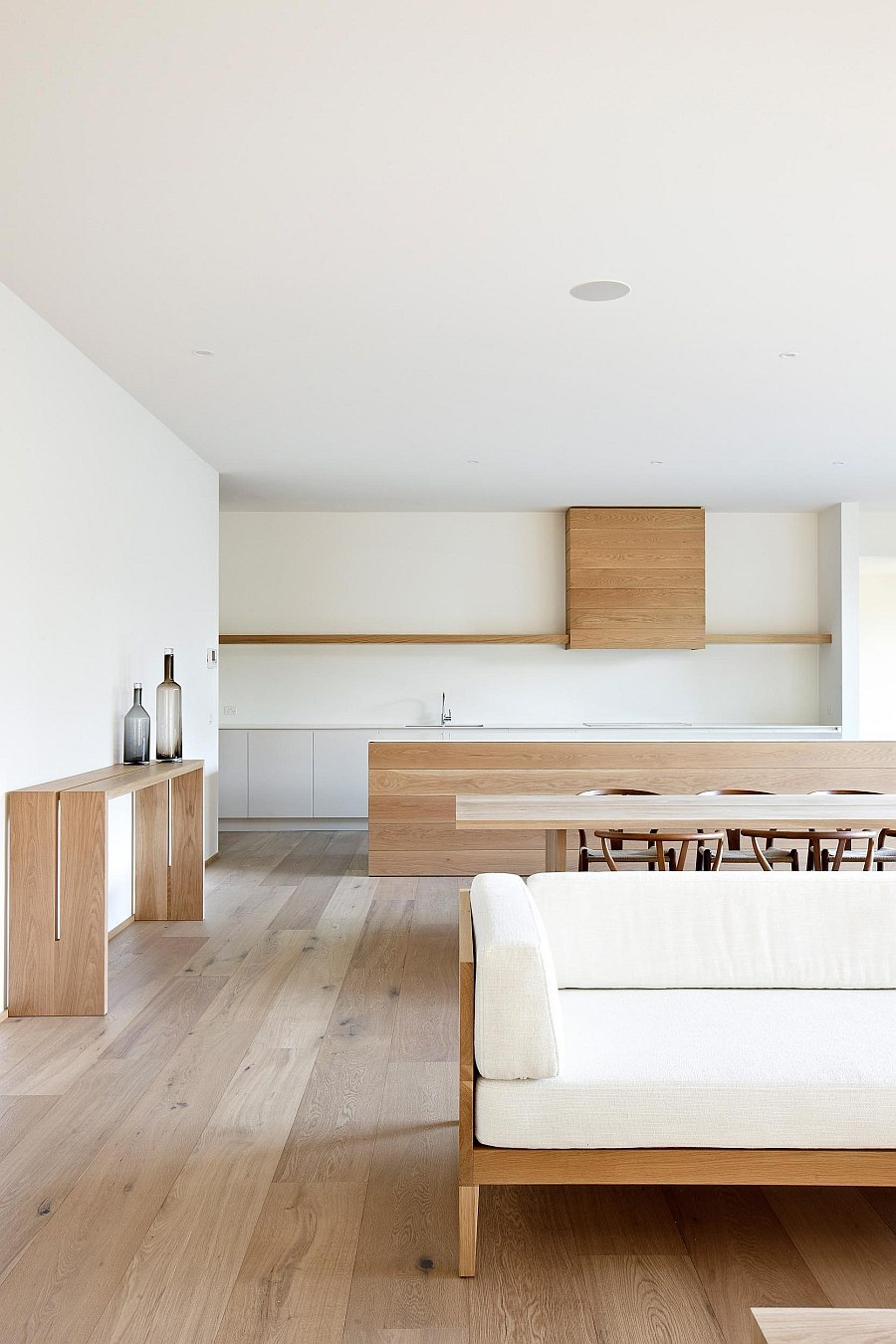 Warm wooden surfaces brighten the minimal interior
