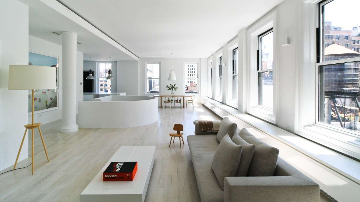 White and bright duplex in the sky pleases with pops of color Modern house architect new york