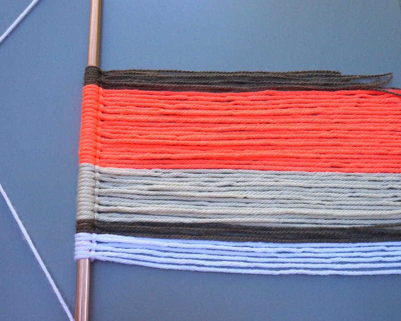 Alternating colors adds contrast to the wall hanging