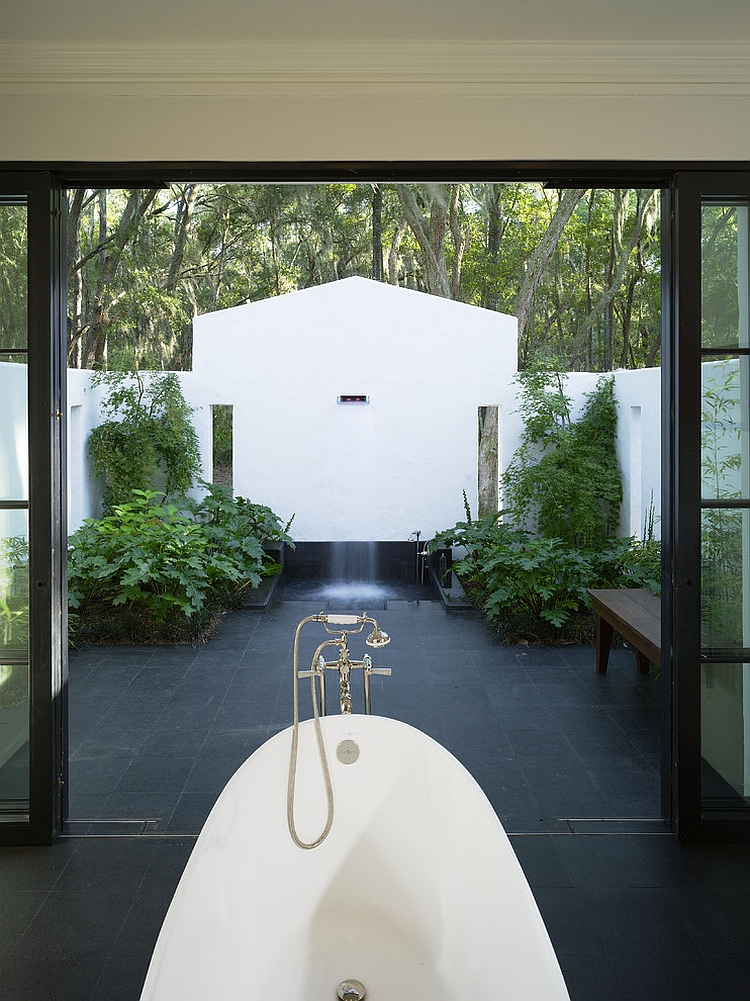 Amazing indoor-outdoor bathroom with shower and bathtub [Design: Summerour Architects]