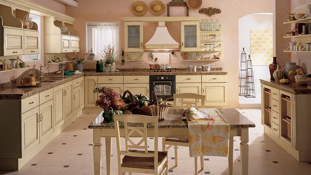 Antique cream and pink dominate teh traditional kitchen