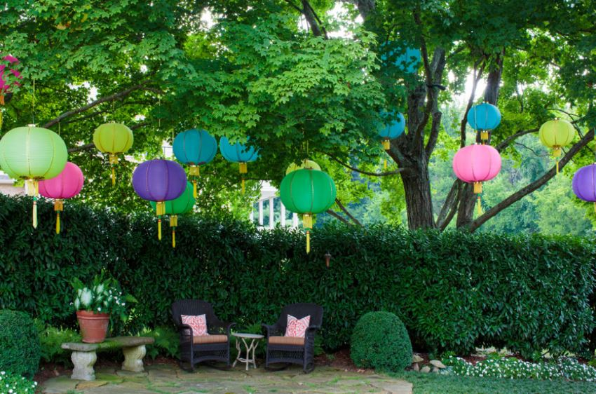 A festive backyard with hanging lanterns