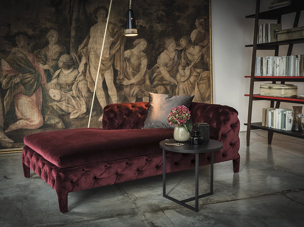 Beautiful chaise lounge in velvet red exudes opulence