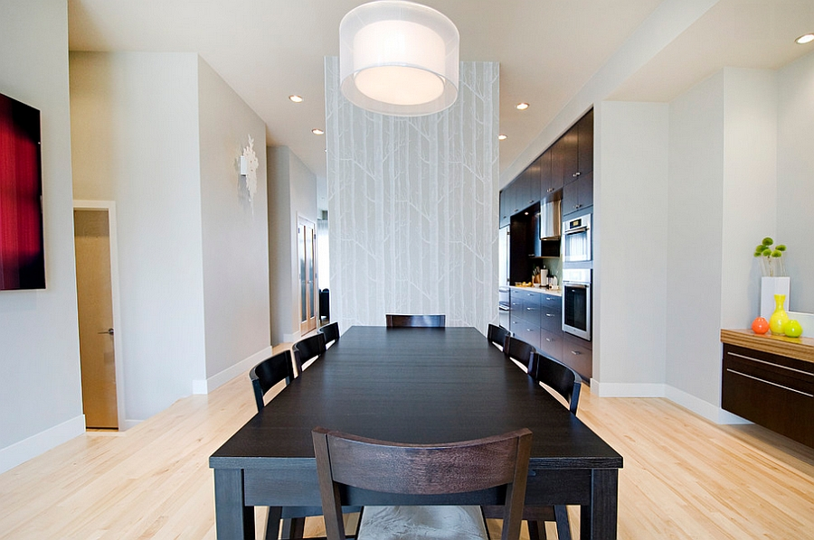 Beautiful wallpaper adorns the wall separating the dining room from the kitchen