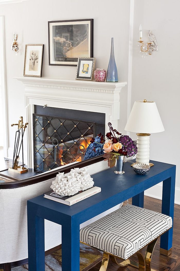 Blue console table and golden accents in the family room