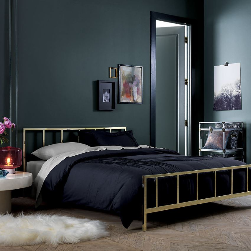 Brass bed in a dark room