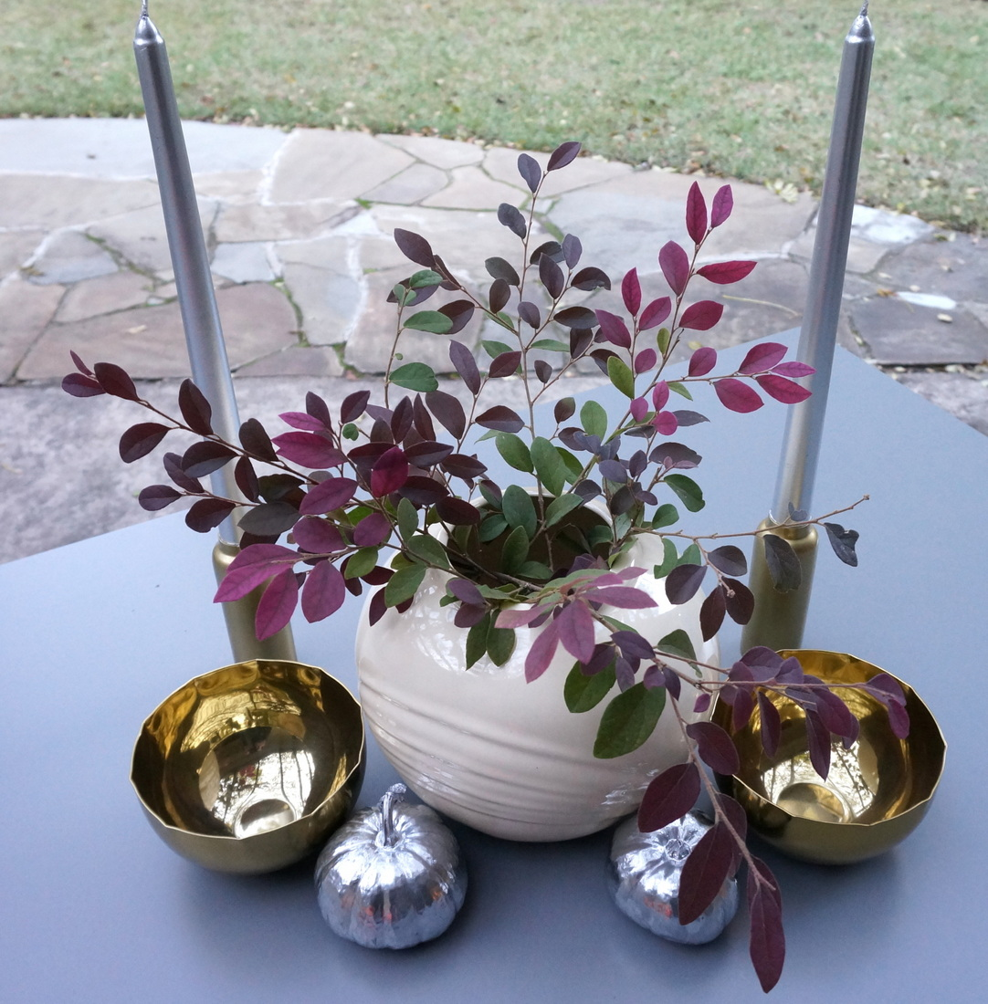 Brass candleholders and bowls add a warm glow to the table