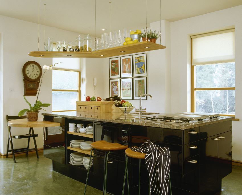 Ceiling-mounted shelving in an artful kitchen
