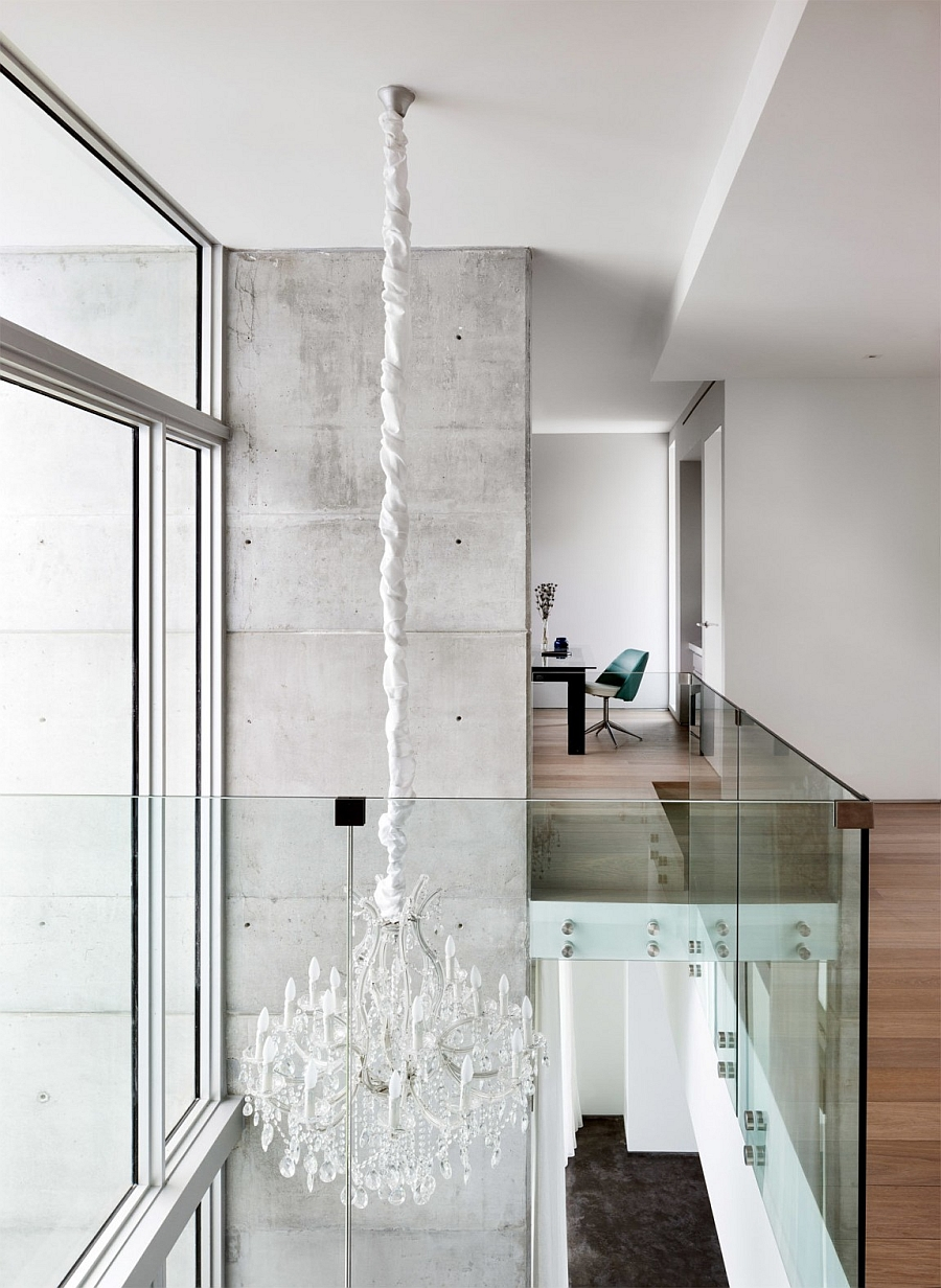 Chandelier from the top level illuminates the lower floor