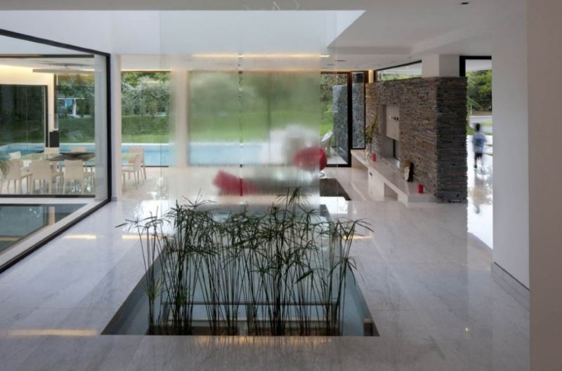 Clean-lined water feature in a modern living room