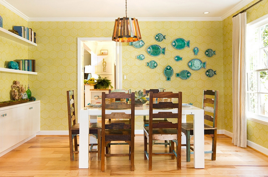 Clever blue accents enliven the yellow dining room [Design: Charmean Neithart Interiors]