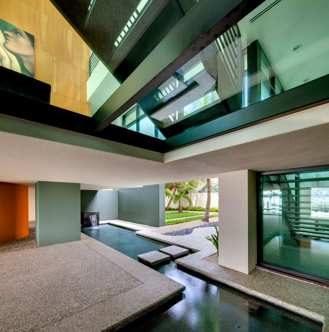 Contemporary entry with a modern water feature