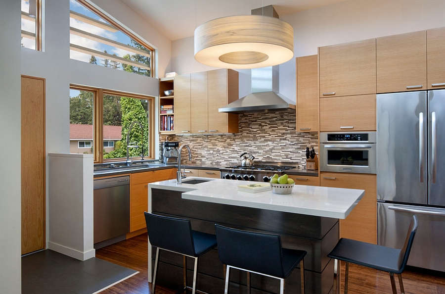 Countertop overhangs give additional counter space without taking up foot room [Design: Ana Williamson Architect]