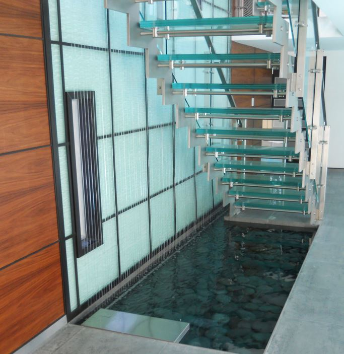 Custom rain curtain next to a contemporary staircase