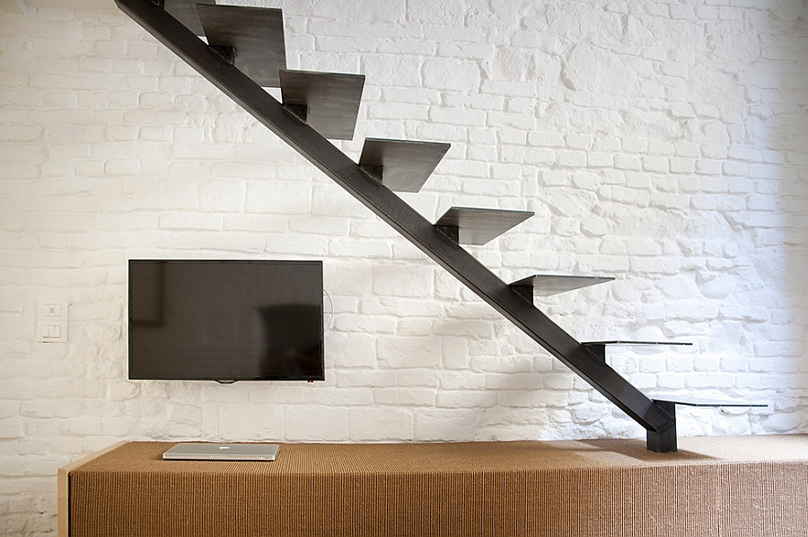 Dark sculptural staircase leading to the top level