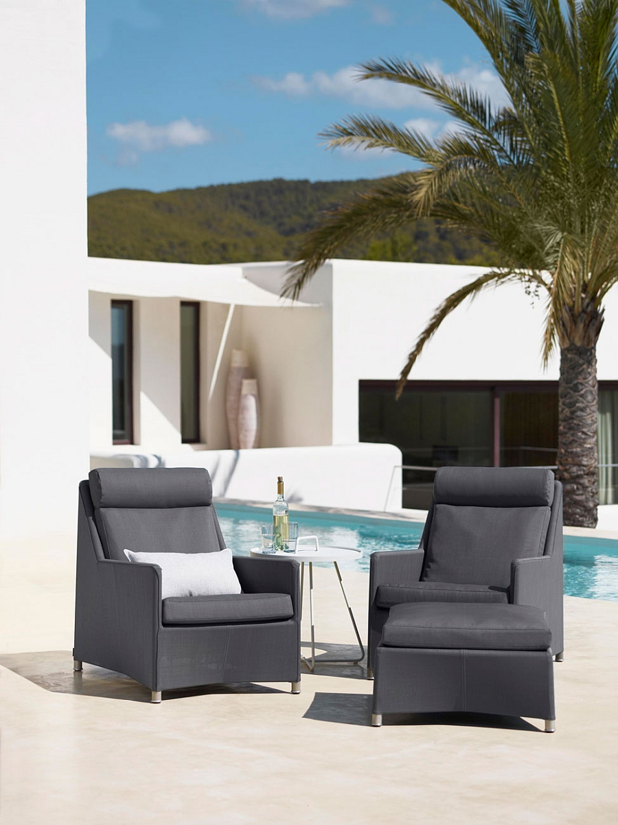 Diamond highback outdoor chairs with footstool next to the pool