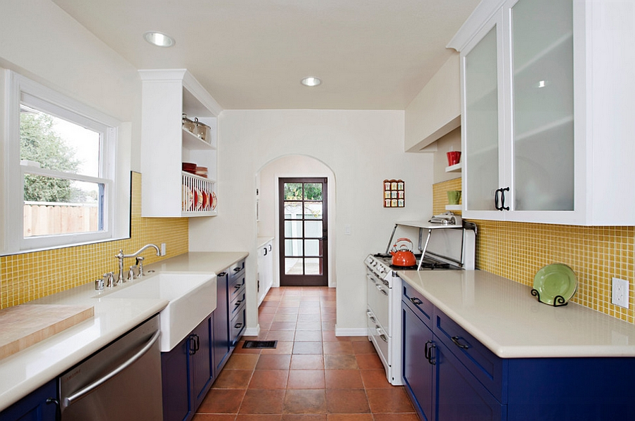 Eclectic kitchen with blue cabinets and yellow tile backsplash [Design: Caisson Studios]