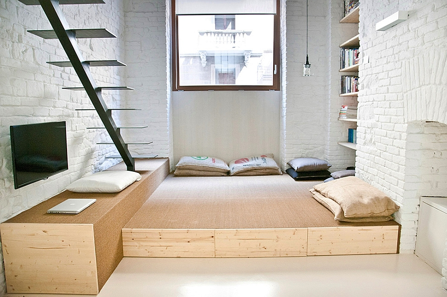 Elegant living area created using a wooden platform Old Shop in Turin Transformed into an Inimitable Contemporary Loft