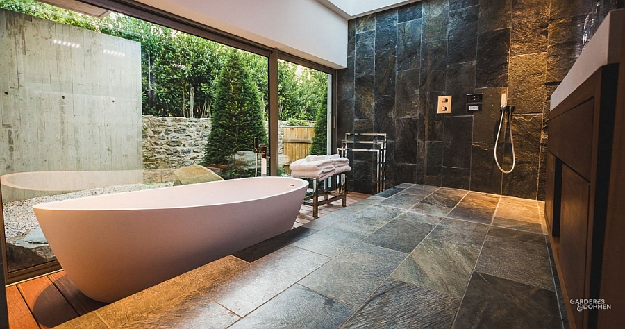 Exclusive spa-styled bathroom design with a large standalone bathtub