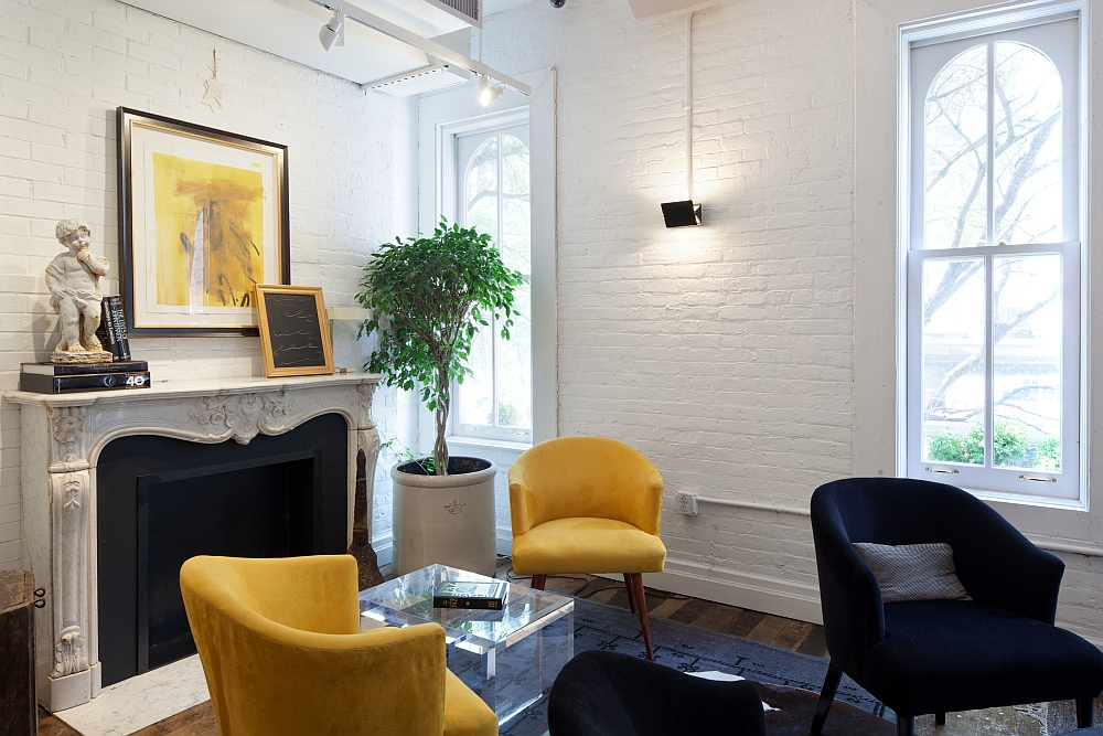 Exposed brick walls pay homage to the past of the building