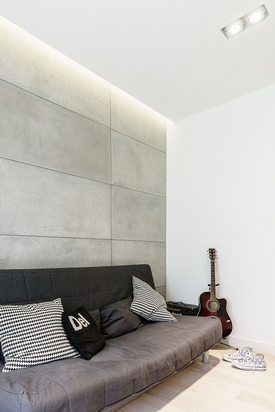 Exposed concrete wall brings contrasting texture indoors