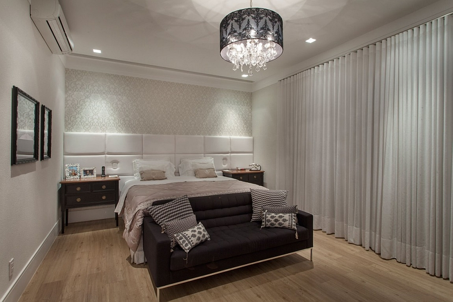 Exquisite master bedroom with a half-tufted wall behind the heardboard